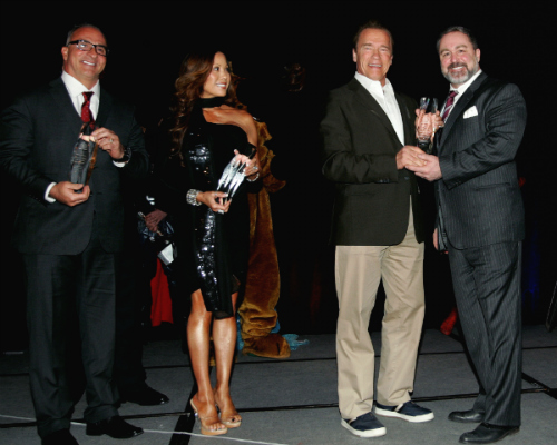 Dr. Pete receives the Pioneer in Fitness Education Award from Arnold along with fellow ESPN fitness stars Rick Valente and Kiana Tom.